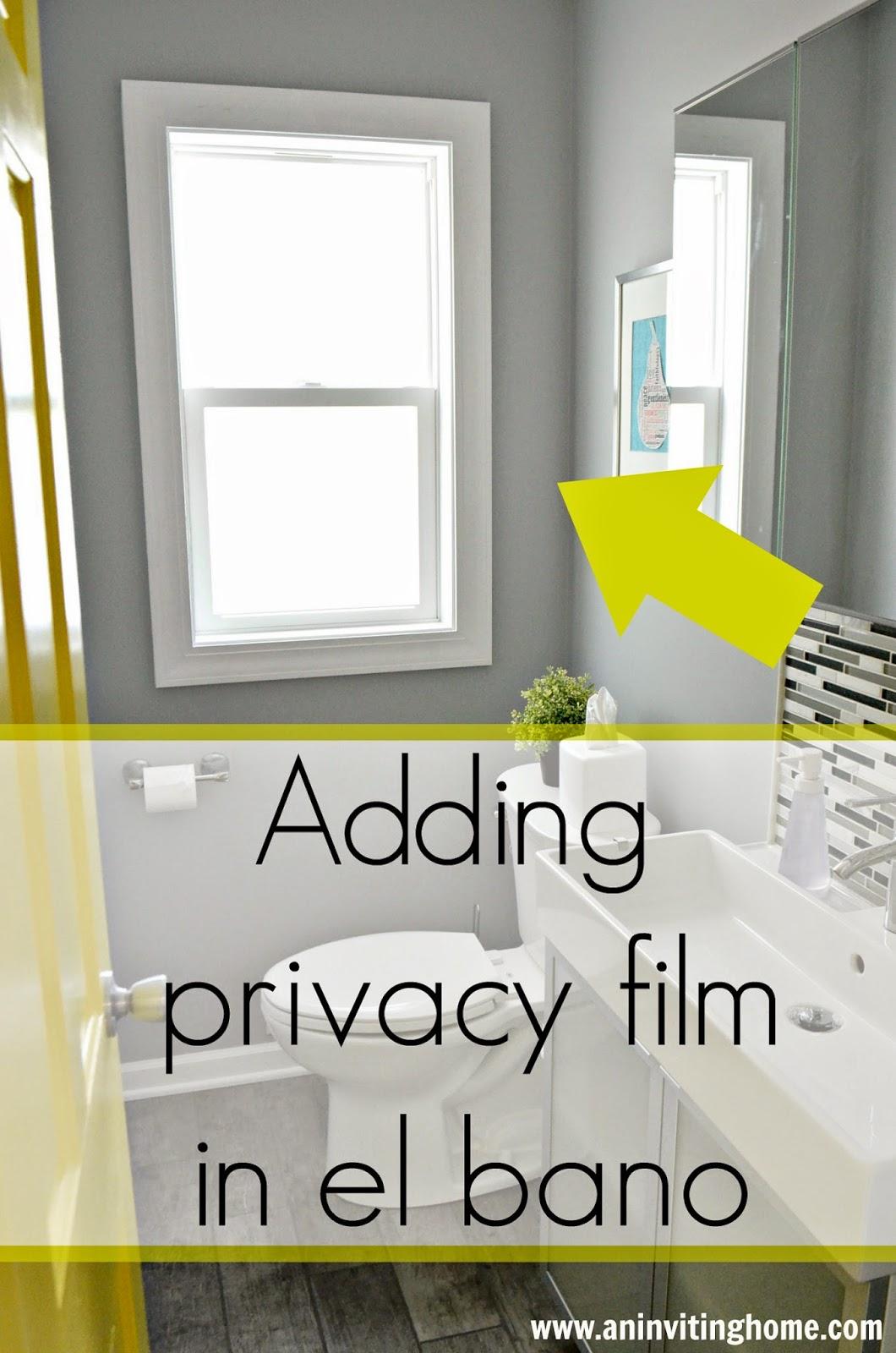 adding privacy film in a bathroom window