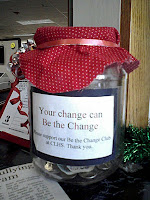 "Glass jar with label: ""Your change can Be the Change."""