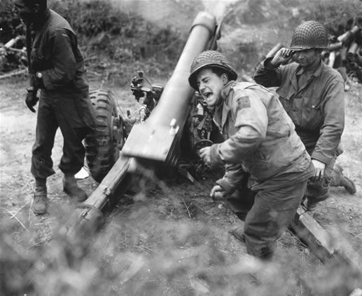 American howitzers shell German forces retreating near Carentan France. July 11-1944