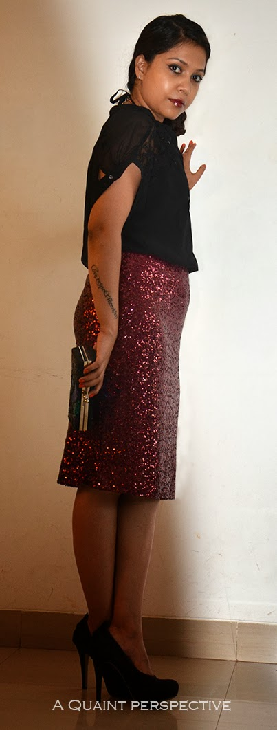 She wears a sequined pencil skirt in the color of the Young Cabernet Sauvignon wine