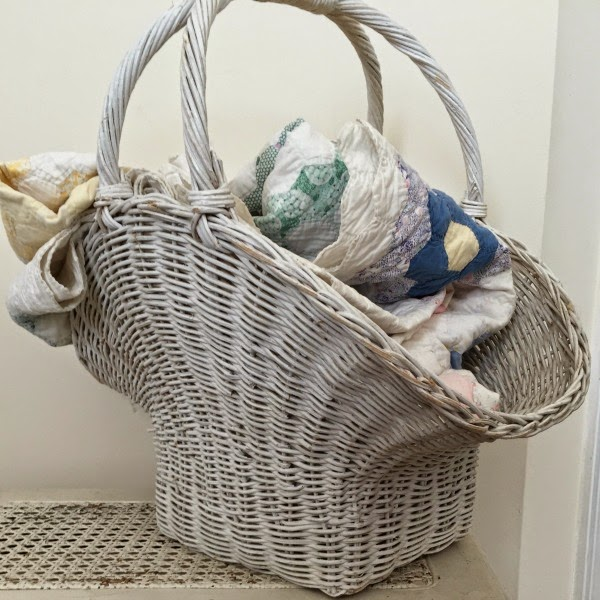 vintage gathering basket and old quilt