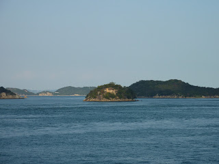 Small island in Seto inland sea taken from a ferry travelling from Naoshima (Miyanoura)to Uno