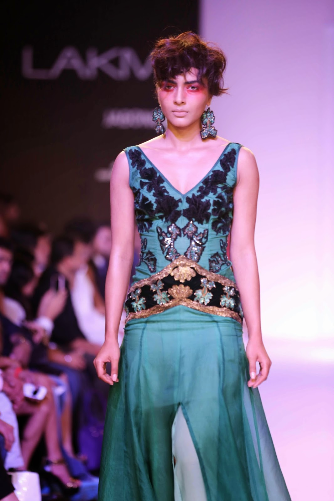 "nspired by the work of artist Franz Kline, Narendra Kumar's collection at Lakmé Fashion Week Summer/Resort 2014 called ""Dark Love"" was a stunning line for men and women."