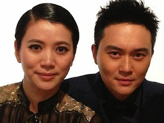 "Anita Yuen sunbathes with ""Captain Cool"""