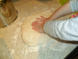 Preparing dough for homemade pizza recipe