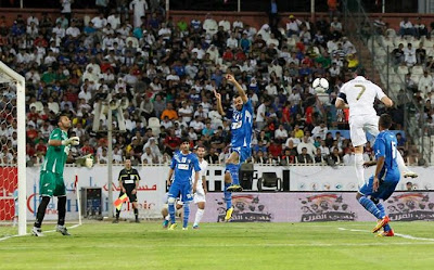 Cristiano Ronaldo jumping to score a goal against Kuwait