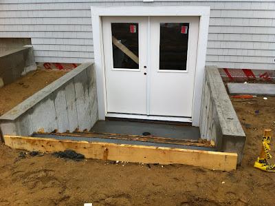 Net zero energy cape cod exterior facade stair for Exterior basement entrance