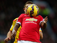 Manchester United's Ashley Young controls the ball during  their English Premier League match against Liverpool …