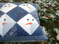 http://www.patchworkposse.com/snowman-pillow-tutorial/