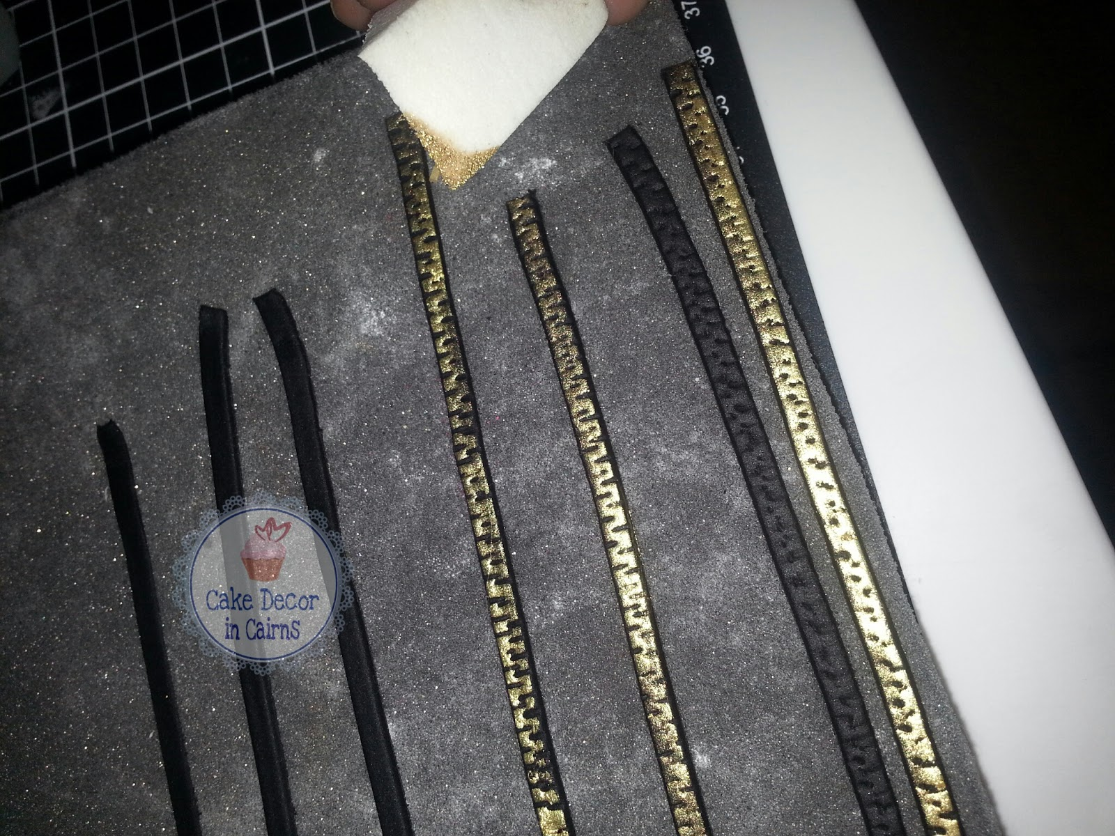 Black fondant, make slits with a blade, colour with cold lustre dust to make your edible zipper for Kim Kardashian Kollection Inspired Cake.