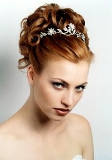 Gorgeous Real Wedding Hairstyles and Updos. Start. Bride with long curly hair embellished with a barrette.