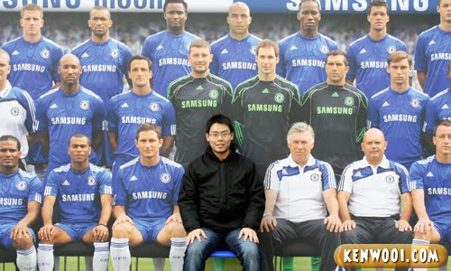 sitting with chelsea team