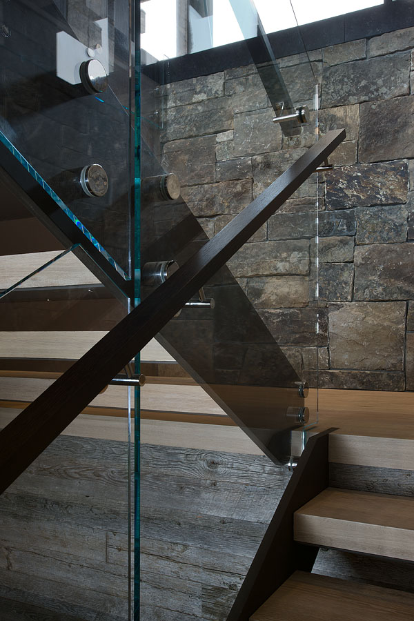 Modern wooden stairs in Elegant Mountain Home by Reid Smith Architects