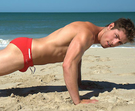 Hot guy in red Speedo on the beach