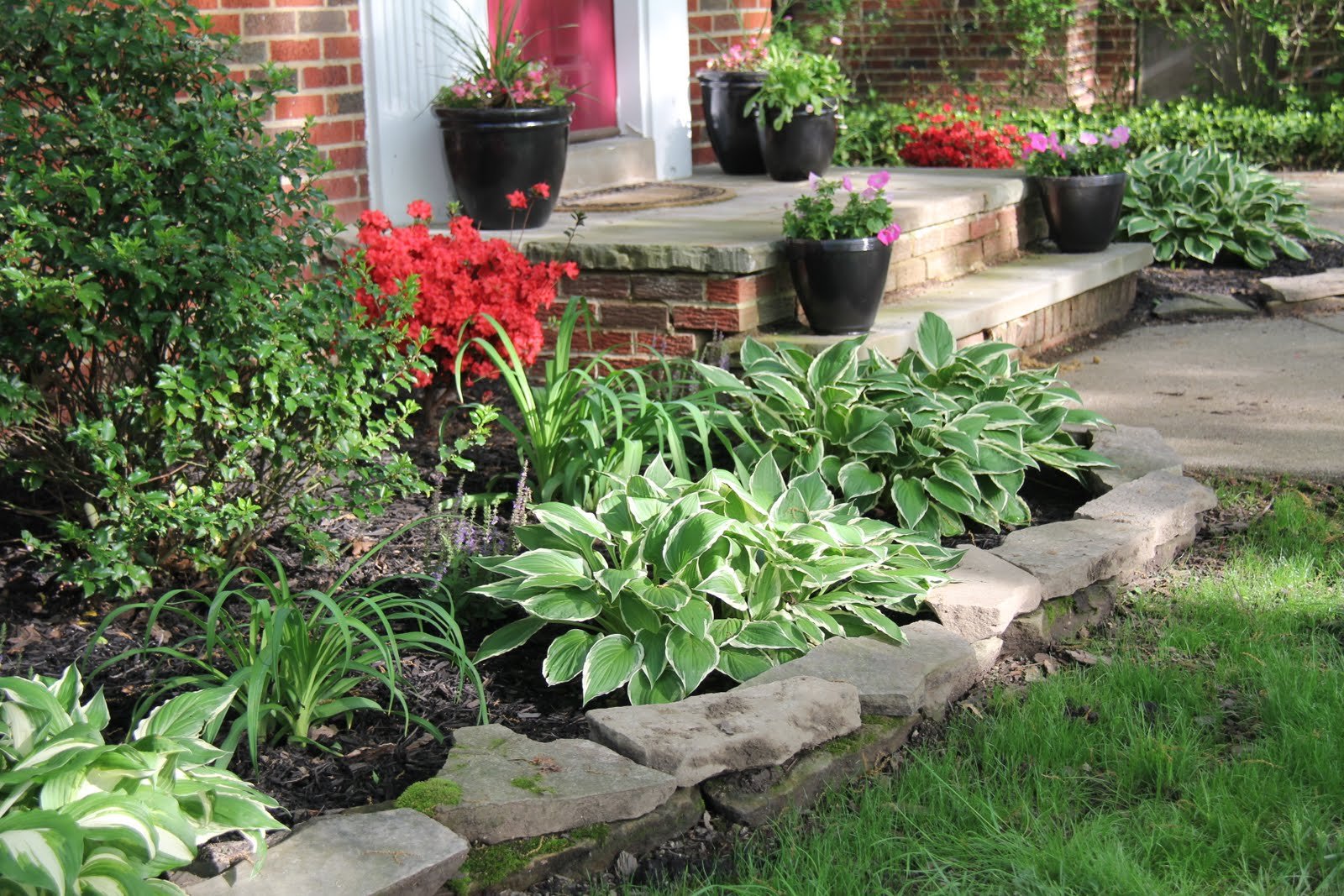 Front yard flower bed ideas photograph front yard transfor for Landscape design flower beds