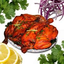 Barbecue chicken is a chicken dish where the chicken is marinated in a spicy yogurt that is seasoned with masala and chili peppers.