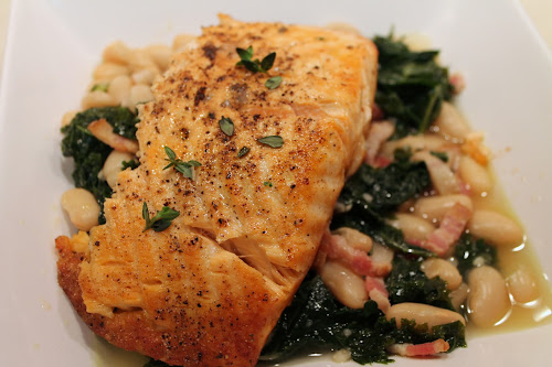 Broiled salmon with white bean, kale and bacon ragout