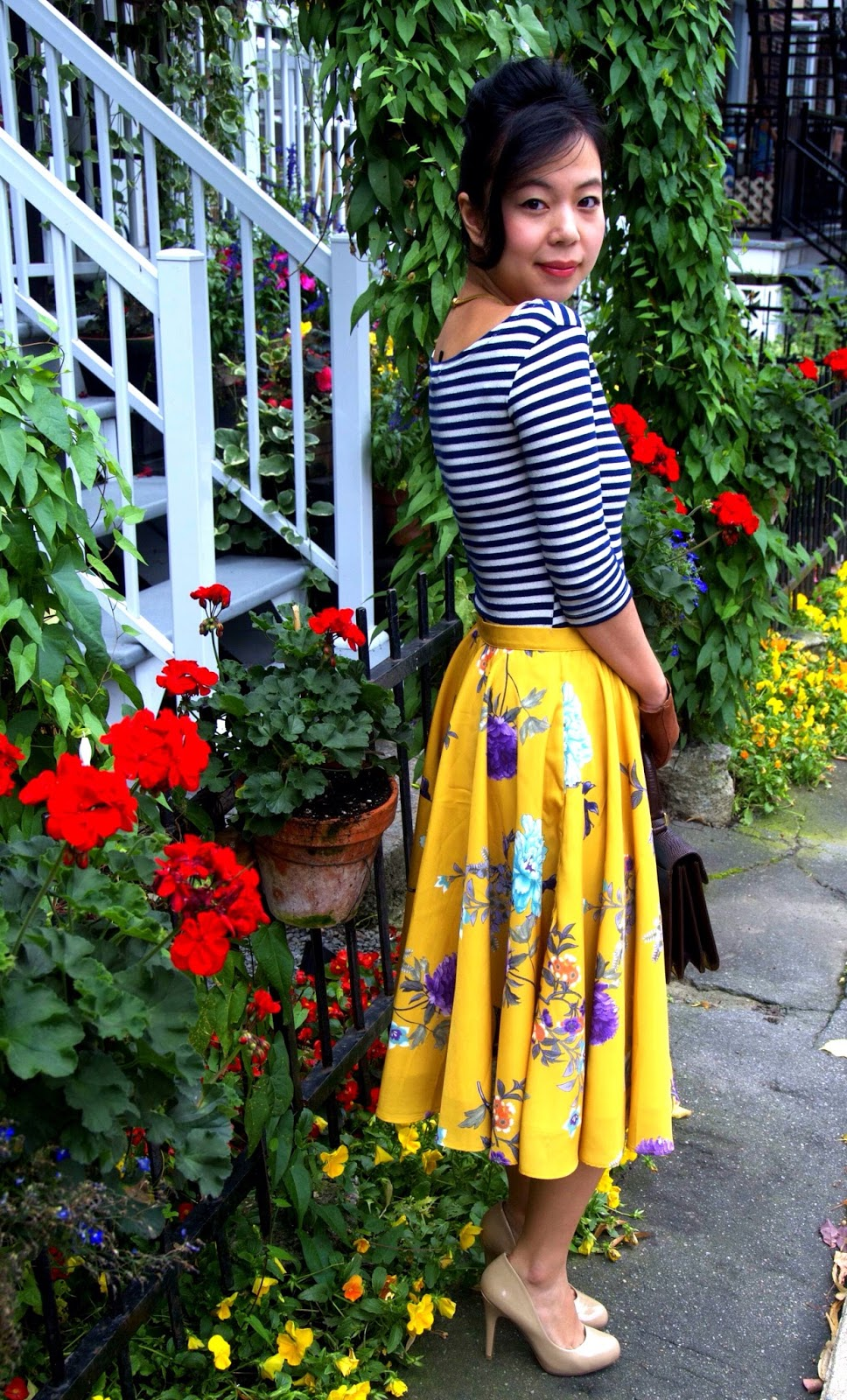 yellow floral skirt leather gloves striped shirt nude pumps heels flowers