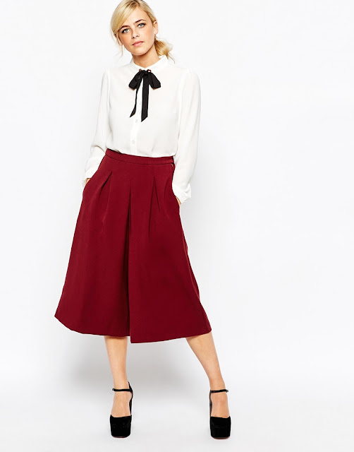 red culottes, white shirt black bow,