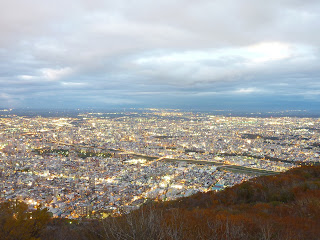 View of the city lights of Sappor cityo taken at night from Mount Moiwa