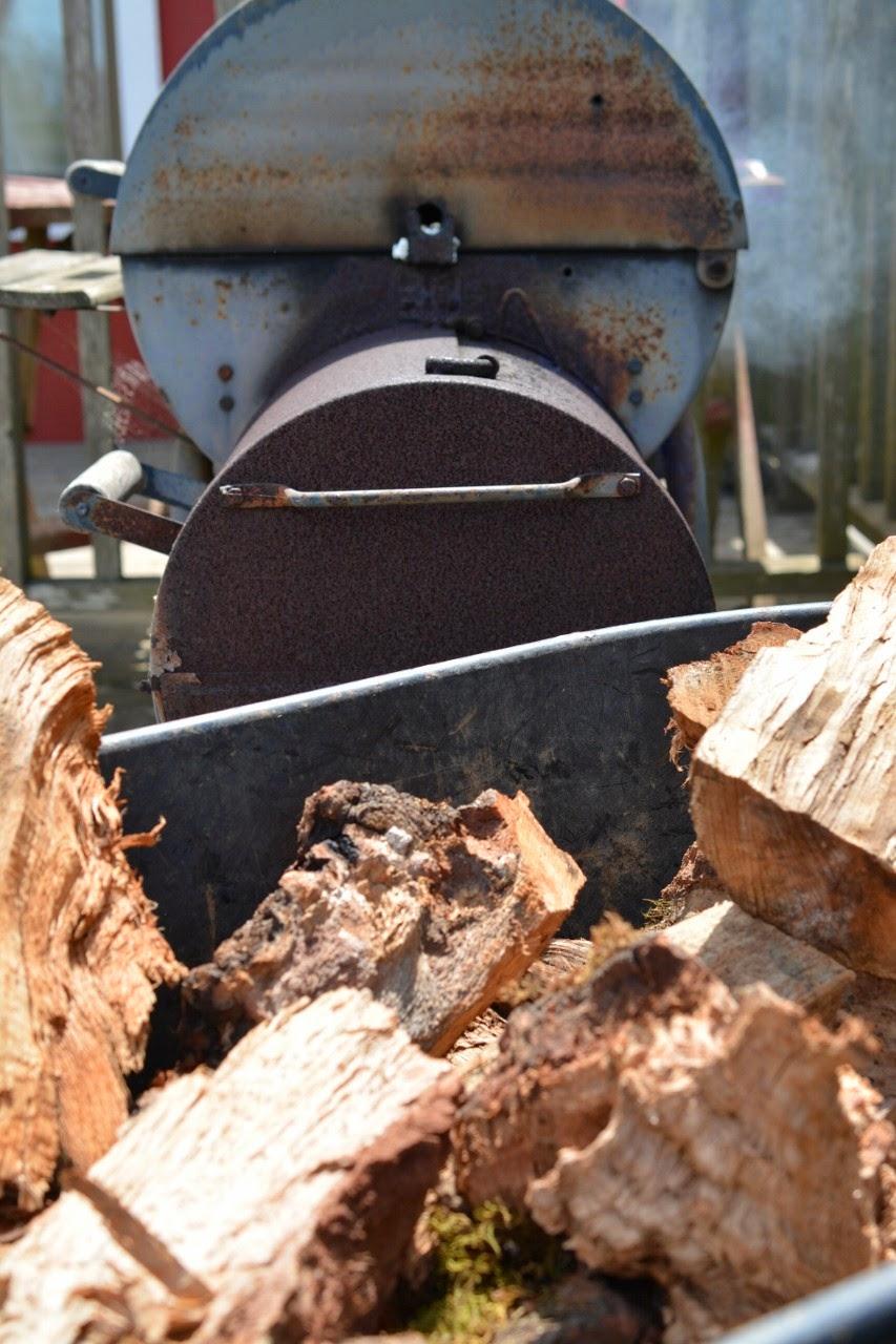 smoker with wood pile