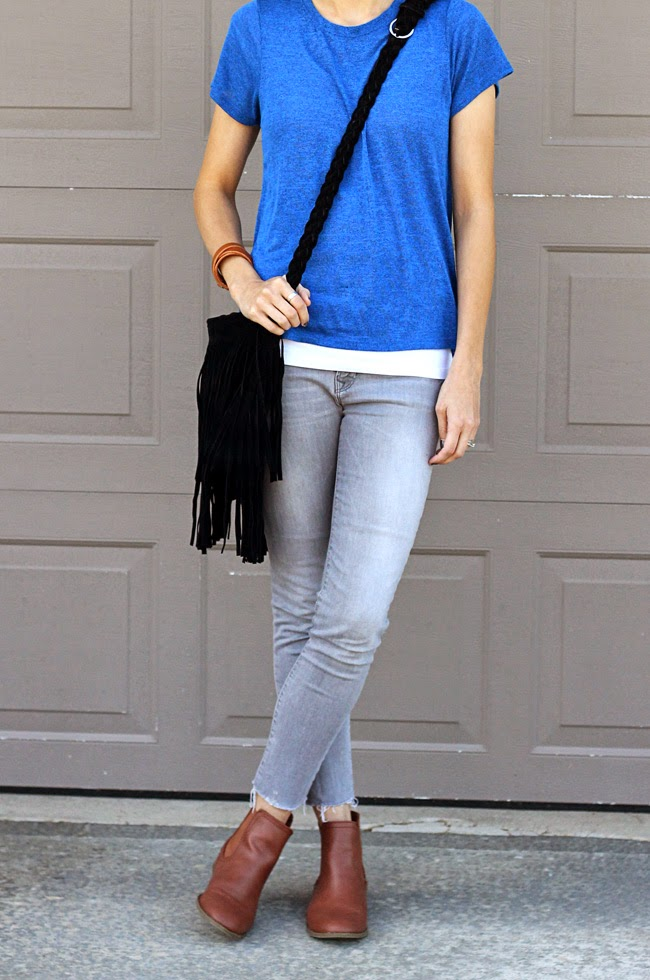 Cobalt blue paired with gray denim, brown ankle boots and a black fringe bag