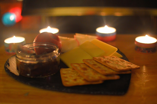 Cheese board by candlelight