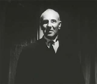 George Zucco as Elwyn Clayton