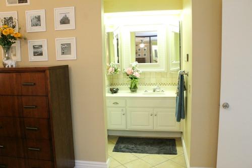 Gray, yellow, aqua midcentury bedroom. clever nest
