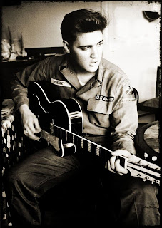 Young Elvis playing the guitar