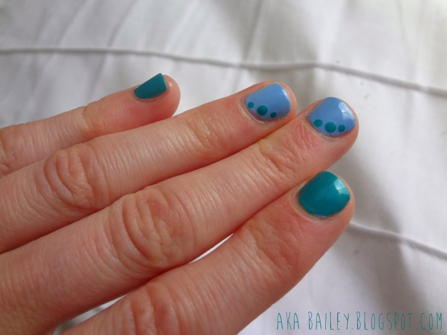 Turquoise nails with light blue accent nails, turquoise dots on the accent nails