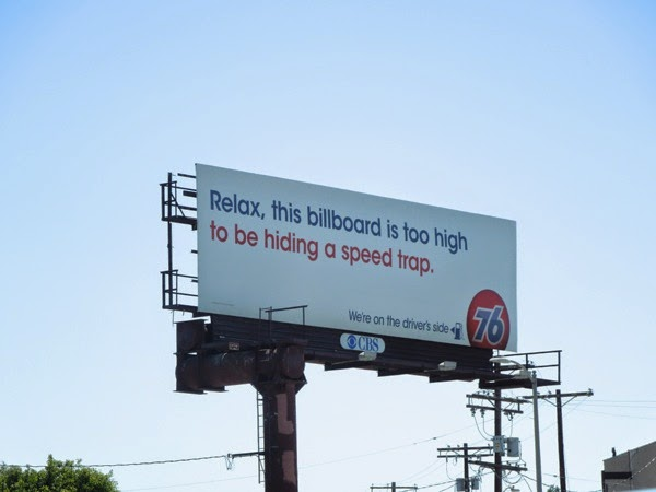Relax billboard is too high be hiding speed trap 76 gas billboard