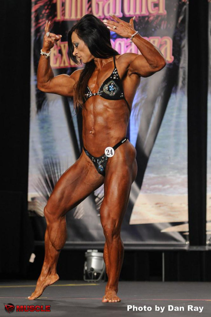 Alicia Alfaro Flexing Her Shredded Physique At The 2012 IFBB Wings of Strength Tampa Pro