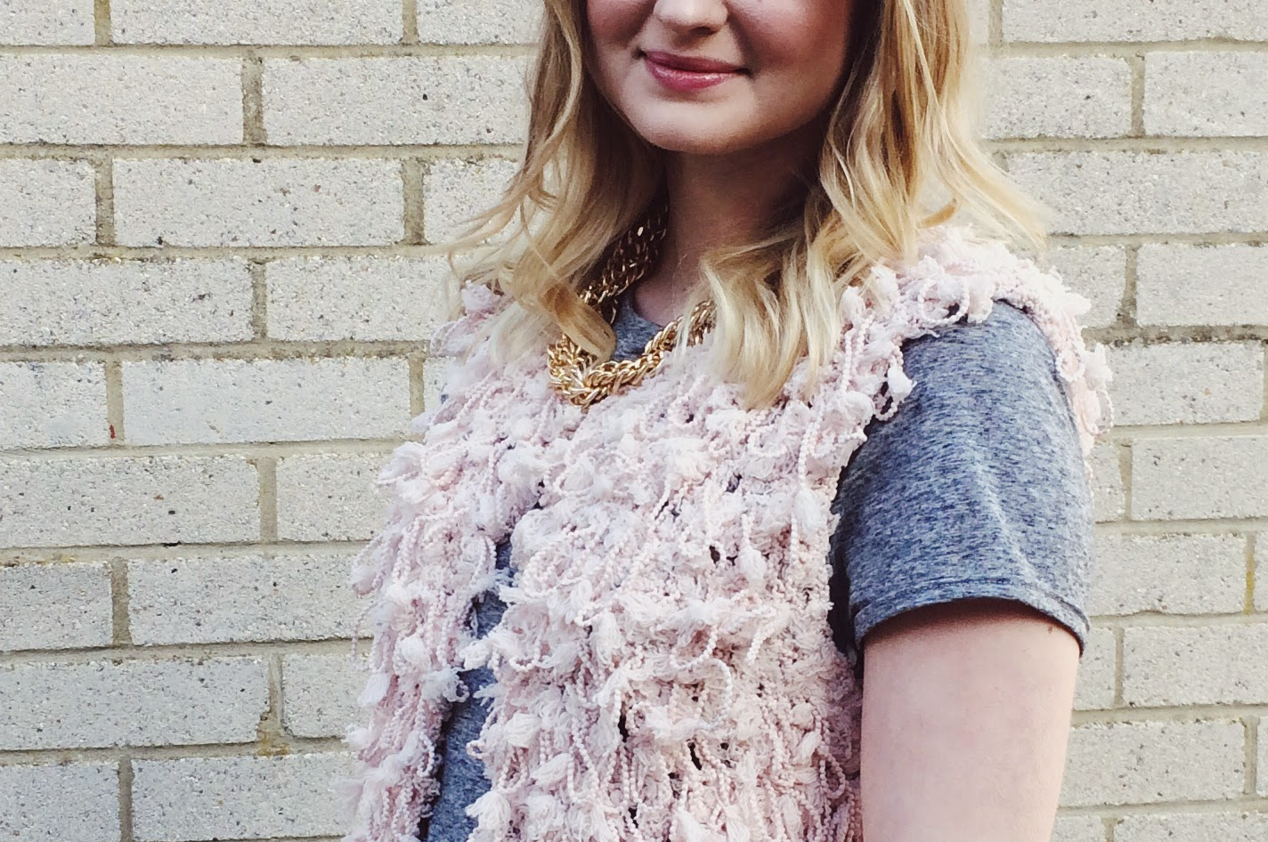 FashionFake, a UK fashion and lifestyle blog. Get cosy and trendy in this pink fluffy gillet by Blue Vanilla!