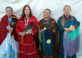 Traditional women in regalia at White Cloud Powwow