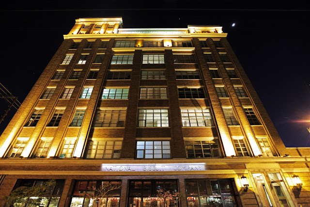 Photo of building at night as seen from the street