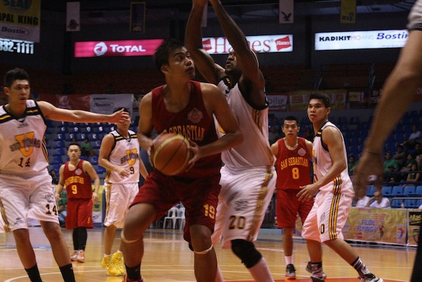 Mark Tano of San Sebastian tries to carve some space underneath the basket.
