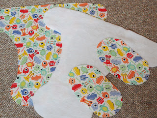 Handmade by Joanne Rich. Materials cut for cloth diaper cover with Velcro tab pockets.