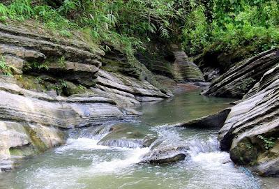 Rocky canal of falling water near Madhabkunda