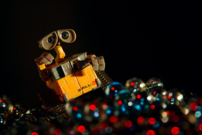 photograph of Wall-e surrounded by red eyes