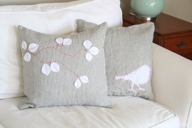 appliqued bird silhouette and fall leaves pillows