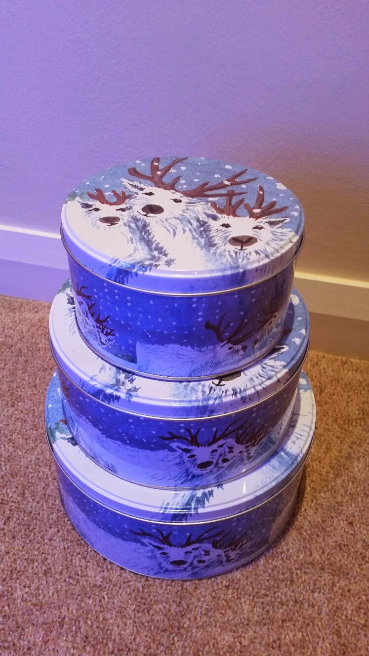 Reindeer storage tins