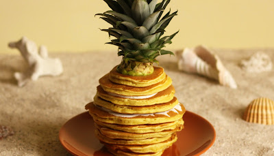Get ready for summer with this fresh pinapple pancake stack with a light yoghurt  and honey with lemon balm dip. This pineapple shaped pancake stack was brought to you by Pancake Stories.