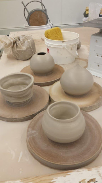 Ceramic pottery wheelthrown and altered pots in progress.