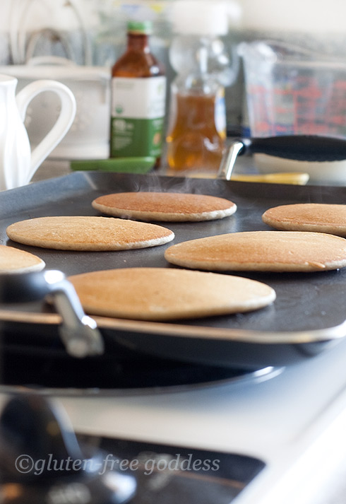 Gluten-free pancakes on the griddle.