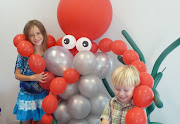 Here is a fun 6 foot balloon Octopus that makes a fun photo opportunity at . (tobi balloon octopus hugging children in under the sea event decor)
