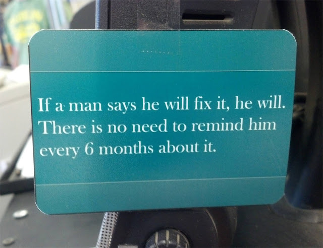 Funny man will fix it sign picture