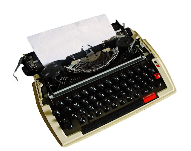 typewriter against white background