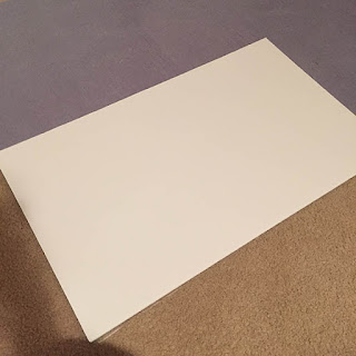 Gluing a white foam core board to the back of a large puzzle