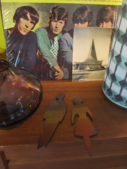 "a vintage Jasba west germany vase , The Spencer Davis Group ""gimme some lovin"" lp , a glass vase Riihimaen Lasi Oy by Aimo Okkolin , toilet symbols , post cards  ( french church with modern architecture)  yard sales garage sales 1950 1960 1970 50s 60s 70s mid century"